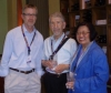 Phil Smith '72, David Weinglass, and Marilyn Carbonell '72